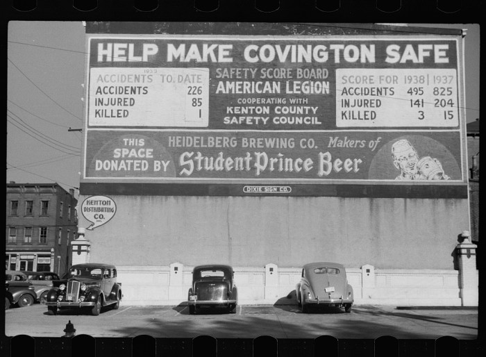 20. A sign painted on a building circa 1935, asking residents to help keep Covington safe.