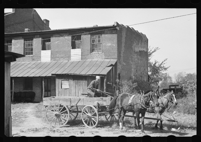 5. A wagon waiting outside a shop in Smithland, 1935.