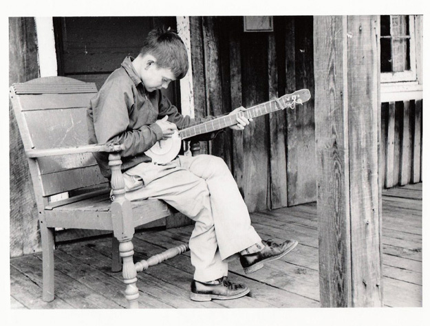 7. A young boy, probably playing some Bluegrass during the Depression.