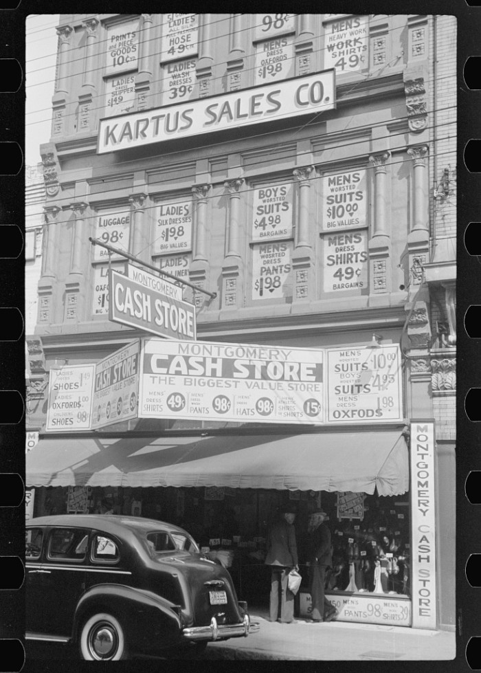 9. Sale signs on a department store, Montgomery - 1939.