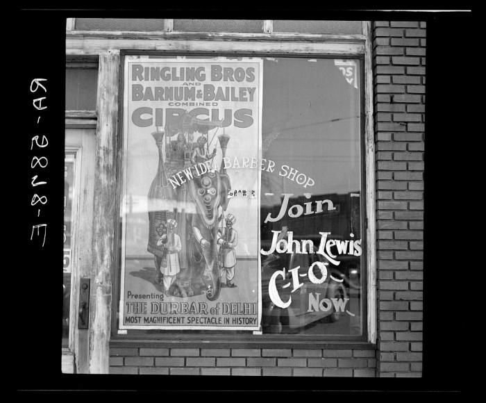 5. A barber shop window, Birmingham - 1937.