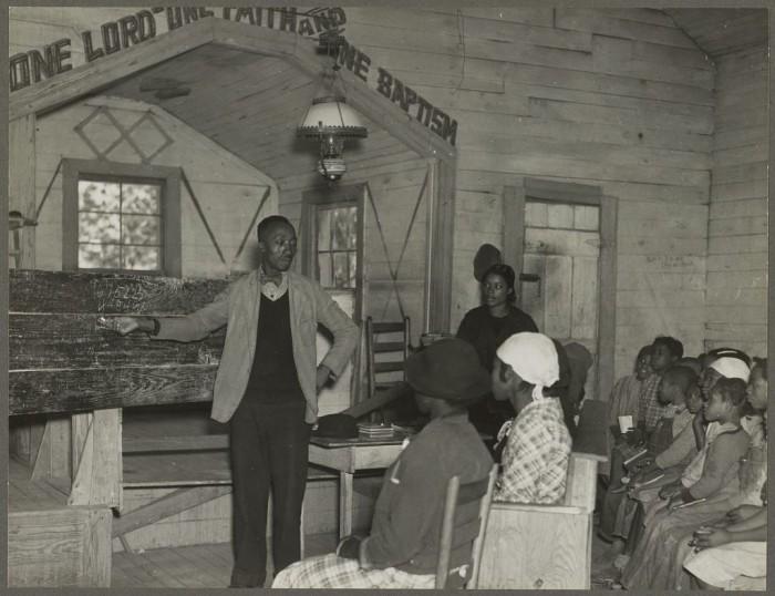 6. A teacher is conducting school inside a Gee's Bend church in 1937.