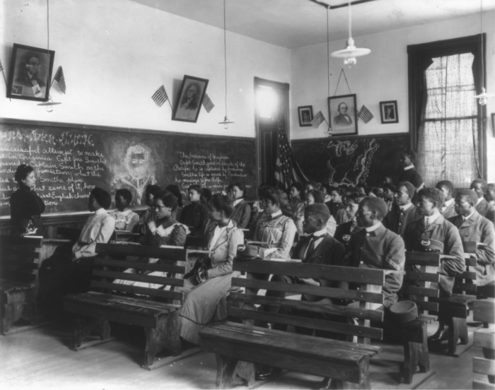 4. A history class is being conducted at Tuskegee University in 1902.