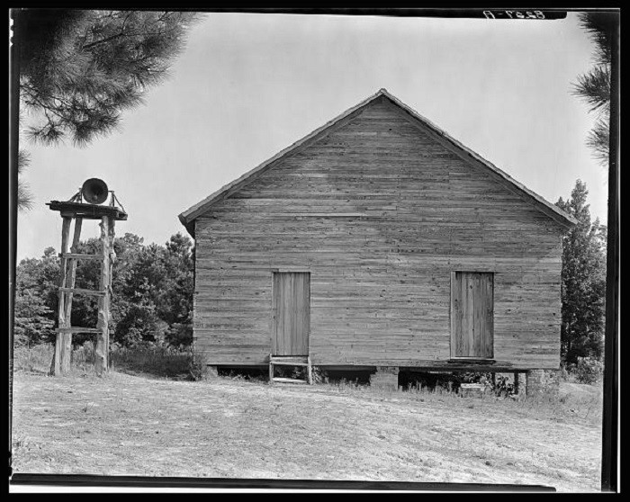 10. This photo of an Alabama schoolhouse was taken in 1936. Check out the bell to the left.