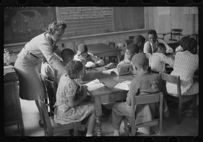 3. A class is being held in the new school at Prairie Farms in Montgomery - 1939.
