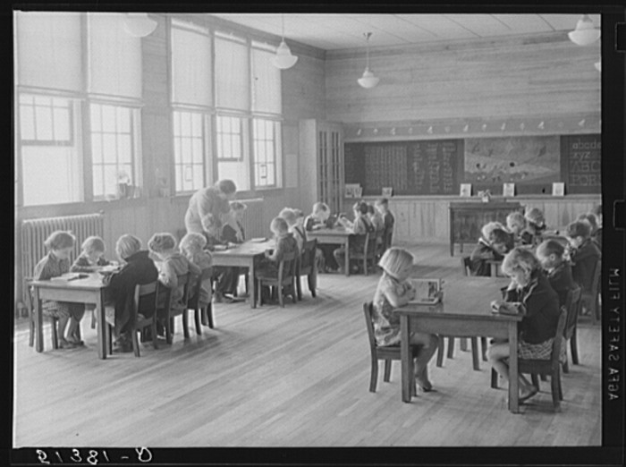 5. A first grade teacher is assisting her students at Goodman School in Coffee County - 1939.