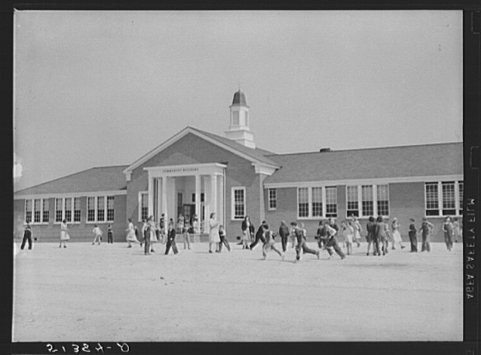 8. It's noon and students are taking a break on the front lawn of Goodman School in Coffee County - 1939.