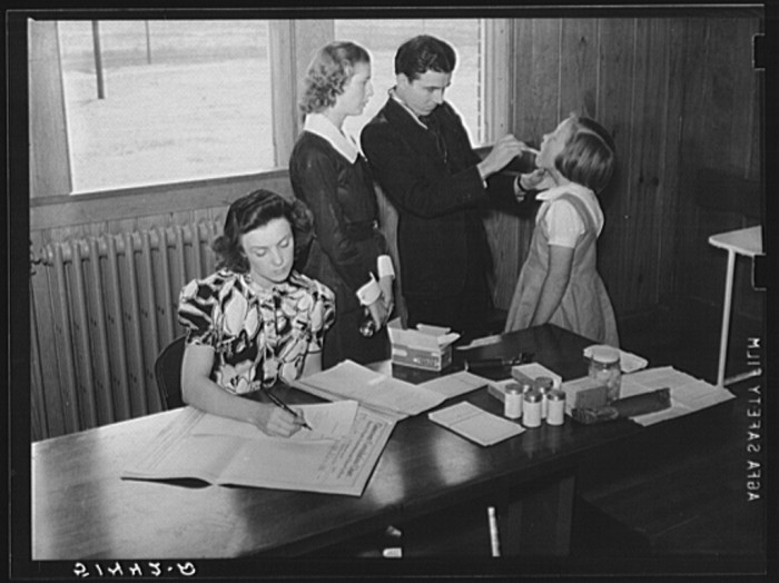 13. A nurse and doctor is examining the throat and teeth of a student at Goodman School in Coffee County - 1939.