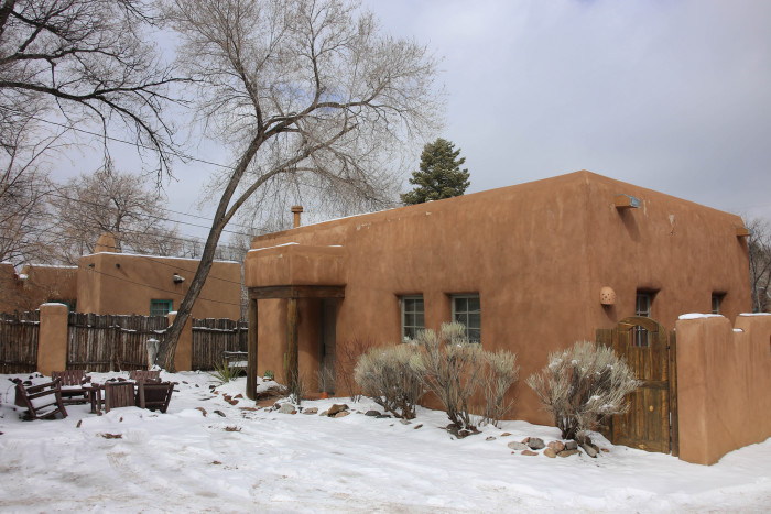 4. The warm earth tones of New Mexico's adobe-style houses emphasize this dramatic contrast in colors.