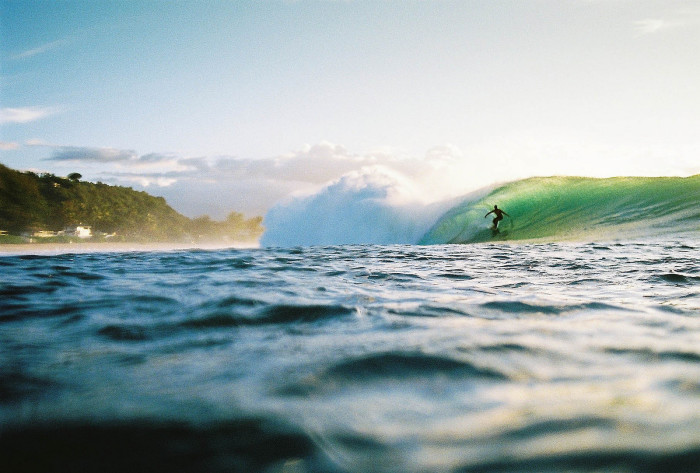 The Banzai Pipeline is known for gigantic waves that break in shallow water just above a sharp, cavernous reef, forming large, hollow curls of water perfect for surfers to tube ride.