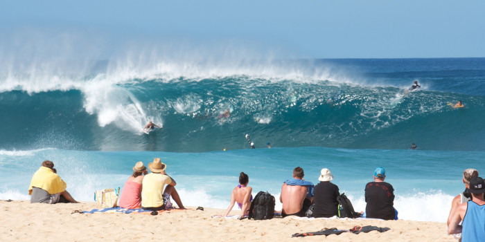 Locals and tourists alike flock to the North Shore to sit on the beach, in awe of the waves, watching professional surfers tackle the legendary Banzai Pipeline.