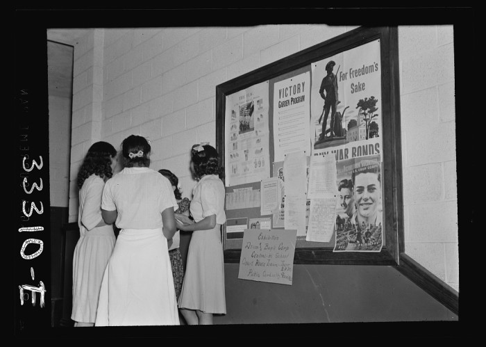 10. Students gather around a bulletin board at Central High School, Charlotte County's all-black high school in Charlotte Court House, June 1943.