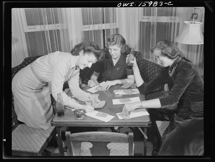 8) Girls playing cards and drinking a soda pop in Detroit, 1941.