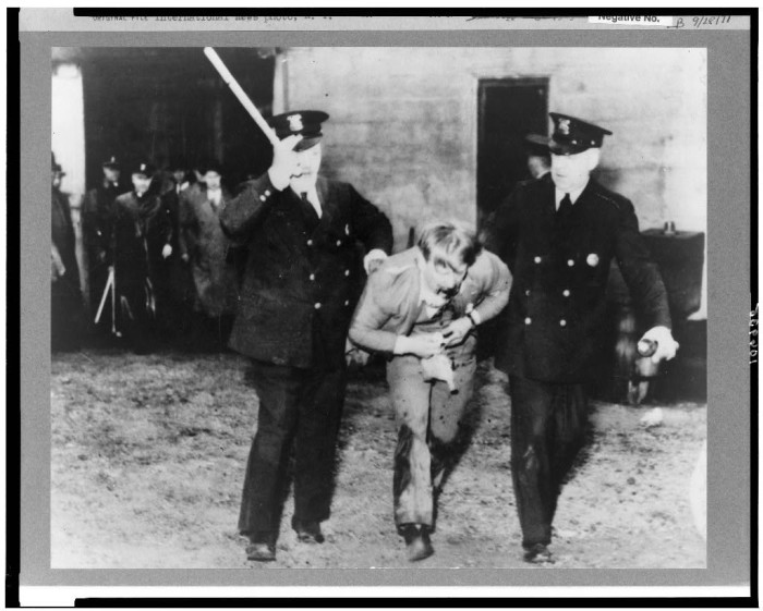 8) Detroit police officers remove sit-down strikers from the Yale and Towne manufacturing plant in March 1937.