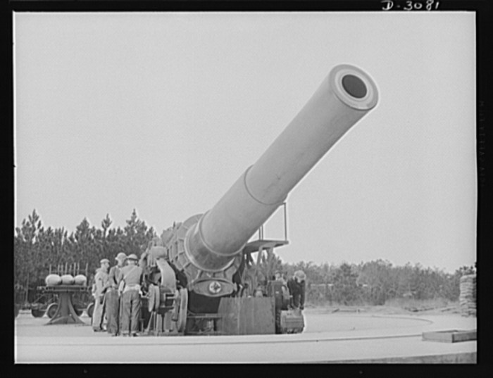 18. A sixteen-inch Howitzer machine gun is put into position by soldiers stationed at Fort Story in Virginia Beach, March 1942.