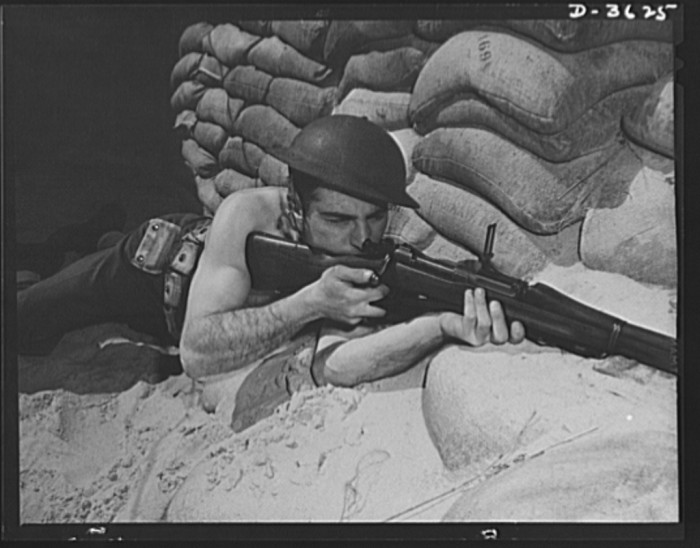 19. A soldier gets into the defense position on the beach at Fort Story, March 1942.