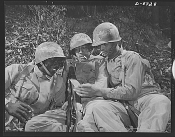 8. A group of African American infantryman rest during training exercises, November 1942.