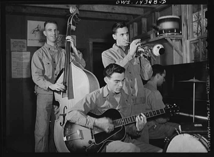 9. Military trainees form a makeshift band to pass the time during training at Fort Belvoir, January 1943.