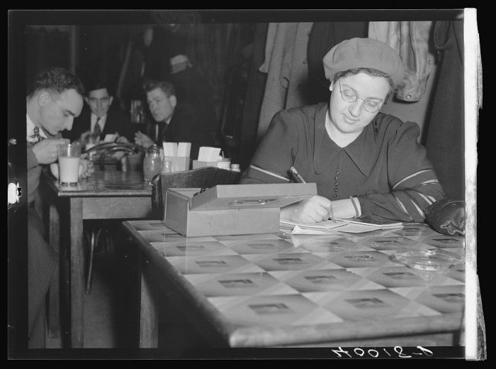 7) Head of UAW Women's Auxiliary kitchen is set up in a restaurant opposite the Fisher body plant No 3 Strikers were fed here and food trucks were sent into the factory twice daily, February 1937.