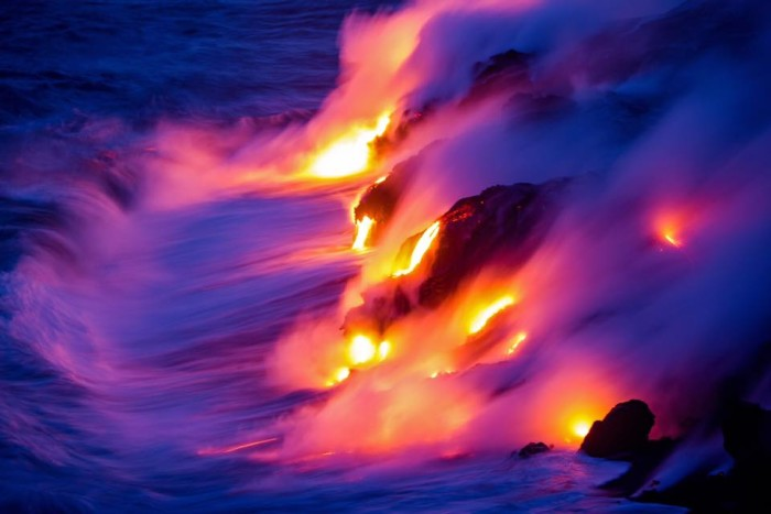 9) Hot lava collides with the Pacific Ocean near Kalapana.