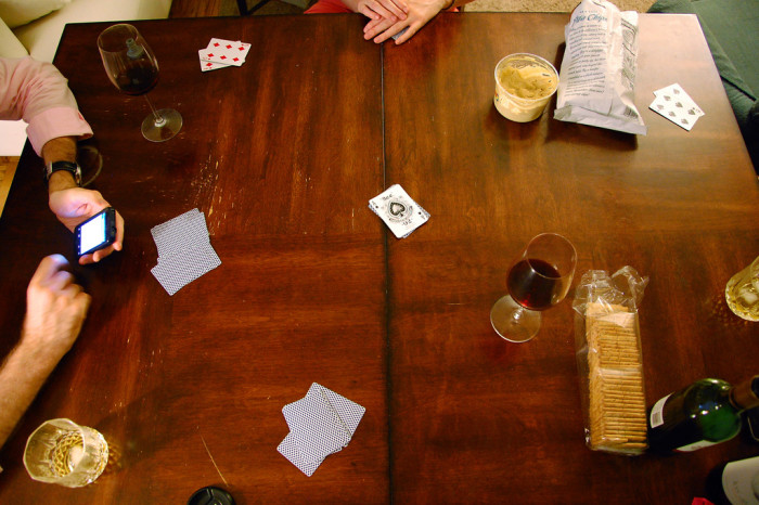 14) How do you play Euchre?