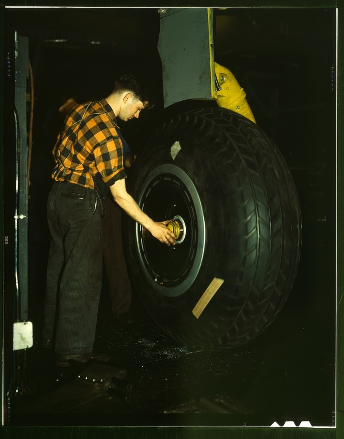 5. Inspecting of landing wheel of the transport planes at Willow Run