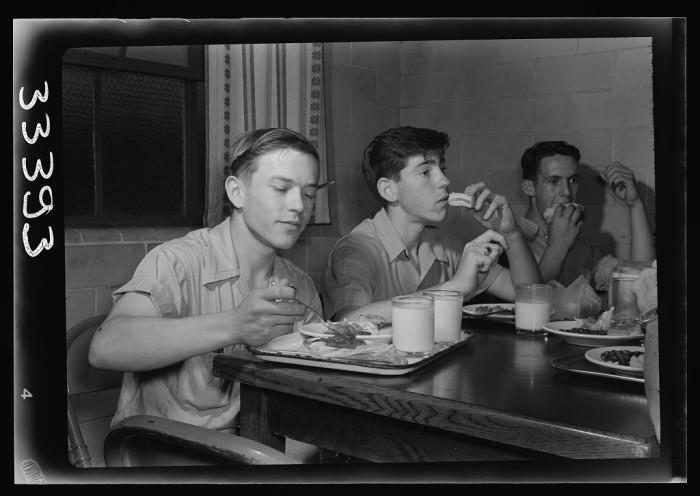 13. Boys eat lunch at Randolph Henry High School in Keysville, June 1943.