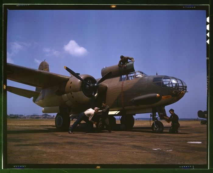 23. A flight maintenance crew services an A-20 bomber at Langley Field, July 1942.