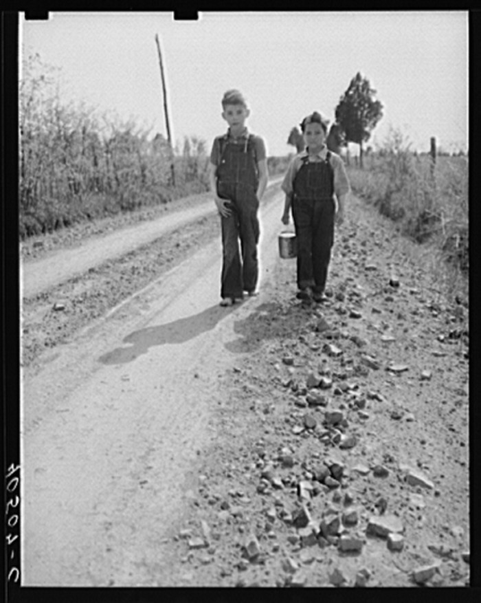 27. Two young boys walk home from school in Loudoun.