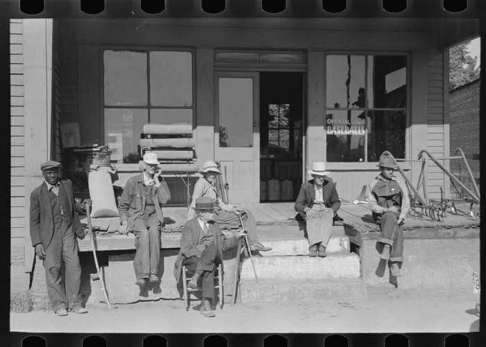 15. Men relax in front of an Irvington store in 1938.