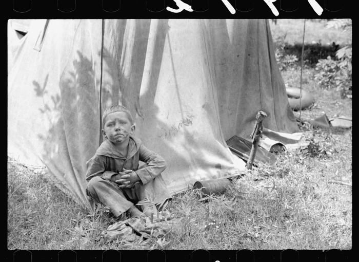 7) Migrant child in front of tent home, Berrien County, Mich