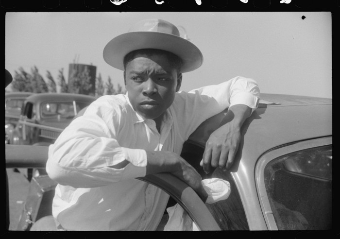14. A young migrant worker waits to cross on the Little Creek Ferry, 1940.