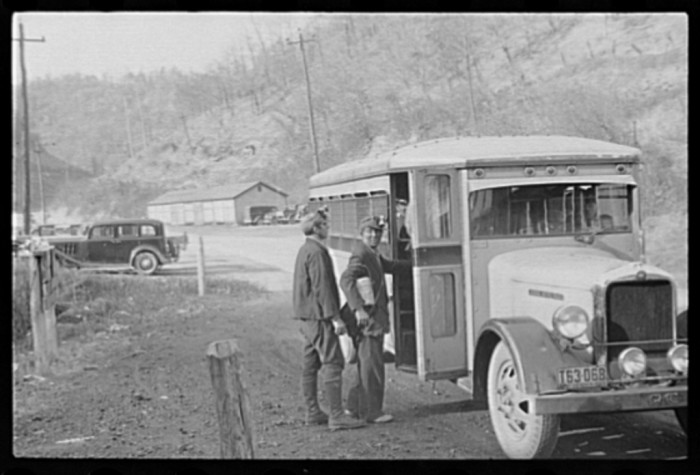 10. Miners catching a coal worker transport, 1935.