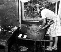 1. Miner's daughter doing laundry without indoor plumbing.