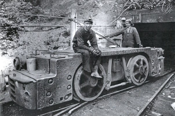 8. Miners waiting to enter the mines with machinery, 1930s.