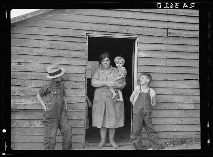 18. Mrs. Dodson with three of her nine children, 1935.