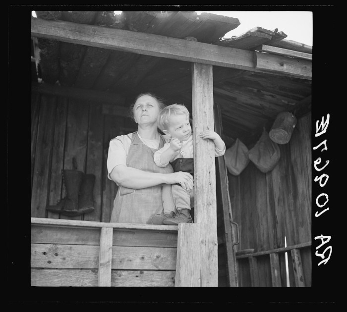 3) Mrs William Sharrard and one of her children, her husband had been a farmer for years but struggled to make a living at it The family is on relief near Silk Lake, May 1937.