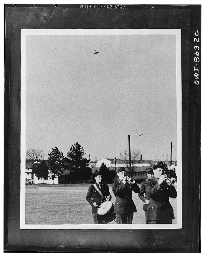 26. An out-of-control A P-40 military airplane begins its spiraling descent towards unsuspecting military musicians at Camp Lee, 1942.