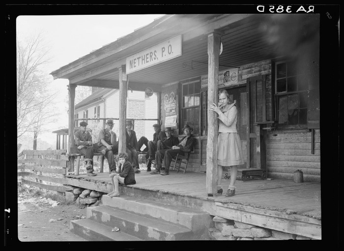 10. Locals gather on the porch of the post office in the small town of Nethers in Madison County, 1935.