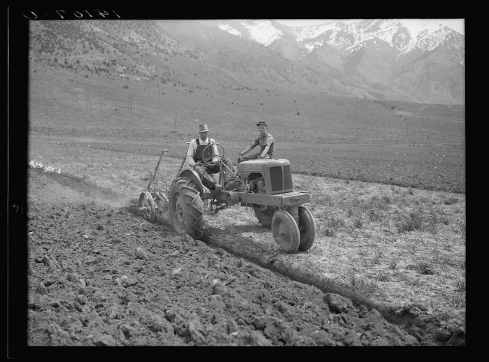 15. Orion W. Snow and his son with their new tractor, purchased with a Farm Security Administration rehabilitation loan.