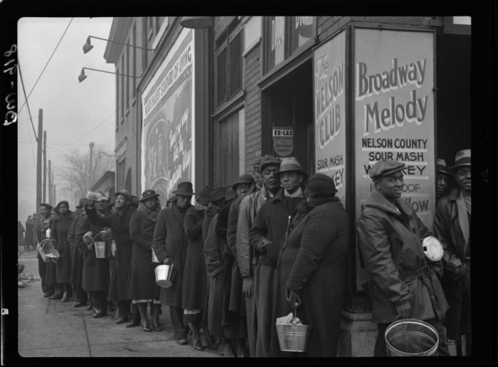 12. People line up in Louisville for food during the Great Depression and the flood of 1937.