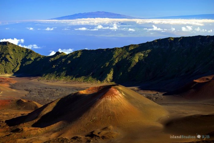 14) Photographed is a cinder cone in the crater valley of Mount Haleakala, with a stunning view of the Big Island in the background.