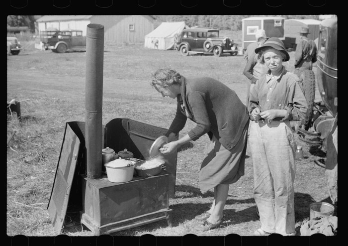 3) Preparing dinner in migrant camp, Berrien County, Michigan