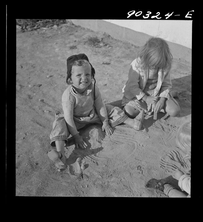 2. Children of a defense worker play in the yard outside of a home in Radford's Sunset Village, October 1941.