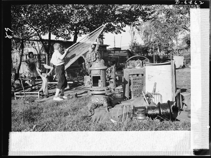 """16. Children gather """"scrap"""" metal from homes in their Roanoke neighborhood and collect it as a contribution to the war effort, October 1942."""