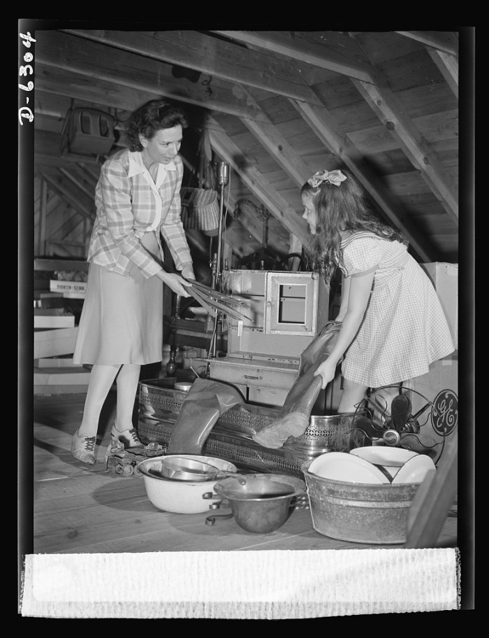 15. On Monday, October 5, 1942, the school children of America, including a large contingent in Virginia, were organized to collect scrap metal for the war effort. Here a mother and daughter in Roanoke raid the attic to see what they have to give.