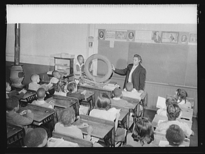 17. A teacher at Gainsboro Elementary School in Roanoke talks about how a used tire can be recycled to make as many as 12 gas masks for soldiers, October 1942.