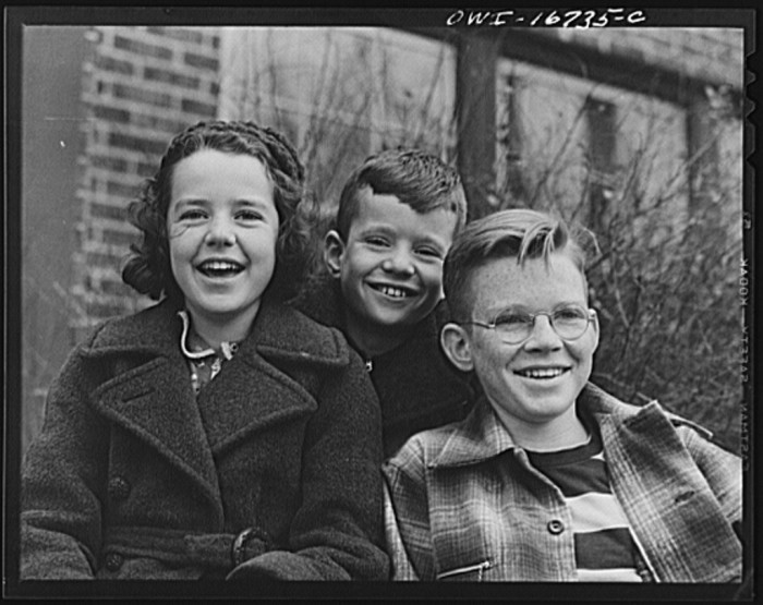 1) Royal Oak, Michigan Portrait of three children in the neighborhood of Father Coughlin's Shrine of the Little Flower, Dec 1939.