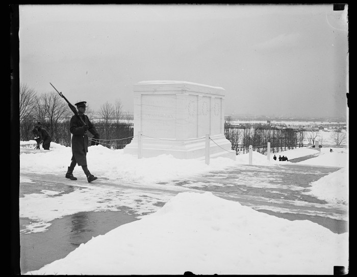 25. A soldier keeping guard at the Tomb of the Unknown Solider in Arlington National Cemetery, 1934.
