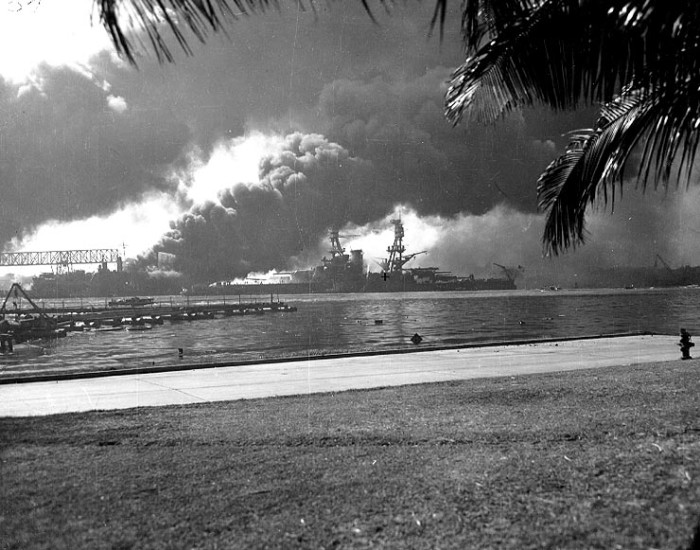 Photographed from the southern shore of Ford Island is the burning USS Nevada.